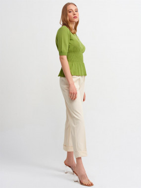 Green fashionable top with cream pant
